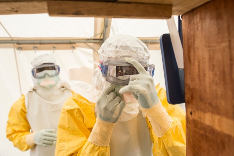 A Doctors Without Borders medical team gets dressed in Ebola protective suits before entering the high-risk area.