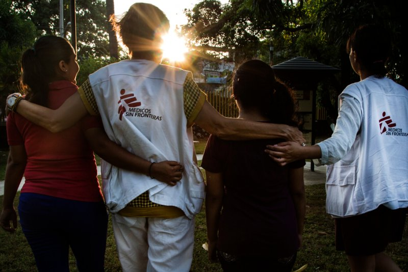 Two Doctors Without Borders social psychologists take a walk with two patients.